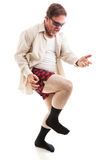 Air Guitar at 50. Fifty year old man in his underwear and sunglasses playing air guitar.   on white Stock Photos