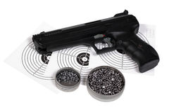 Air gun with gun-shield and pellets in box Stock Photography