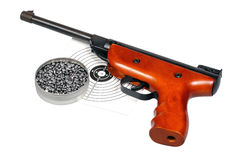 Air gun with gun-shield and pellets in box Stock Photos
