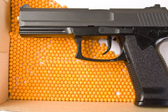 Air gun and pellets. Air gun and yellow pellets Royalty Free Stock Image