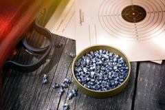 Air gun, pellets for rifle and paper target Stock Image