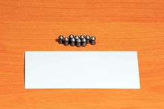 Air gun pellets on wood background Royalty Free Stock Images