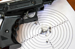 Air gun with a target and a few pellets Royalty Free Stock Image