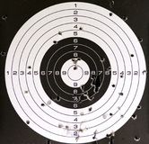 Air gun target and holes. Used air gun target with holes and bull-eye hitted Stock Photos