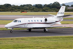 Air Hamburg Cessna 560XL Citation XLS. D-CXLS private plate taxiing on Manchester International Airport taxiway Stock Images
