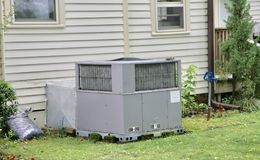 Air handling unit. Provides  central heating and cooling service to a home Stock Image