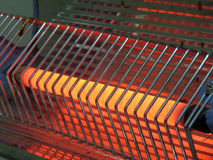 Air Heater. A closeup view of an electric heater coil which is red hot after being at high temperature Royalty Free Stock Photos