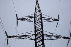 Air high-voltage transmission lines of electric energy. Overhead lines lay electricity above ground through wires attached to royalty free stock photo