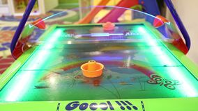 Air hockey, children`s playroom slots, children`s entertainment, Games For Children. Little girl playing air hockey game stock footage