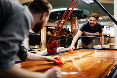 Air hockey is fun even for adults Royalty Free Stock Images