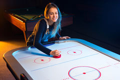 Air hockey game is fun even for adults Stock Photos