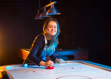 Air hockey game is fun even for adults Stock Images