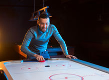 Air hockey game is fun even for adults Royalty Free Stock Image