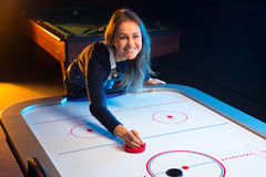 Air hockey game is fun even for adults Royalty Free Stock Images