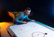 Air hockey game is fun even for adults Royalty Free Stock Photography