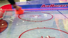 Air hockey game. People playing in Air hockey game stock video footage