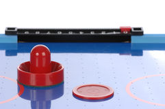 Air hockey paddle and puck Royalty Free Stock Photography
