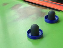 Air hockey table closeup with paddle. At amusement arcade Royalty Free Stock Images