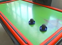 Air hockey table closeup with paddle Royalty Free Stock Photo