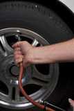 Air hose and tire Stock Photography