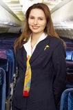 Air hostess. In the empty airliner cabin Stock Photos