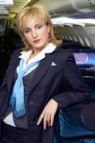 Air hostess. (stewardess) in the empty airliner cabin Stock Photos