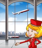 Air hostess at airport Royalty Free Stock Photo