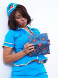 Air hostess checking her wallet Stock Images