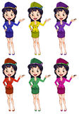 An air hostess with different uniforms Royalty Free Stock Photo