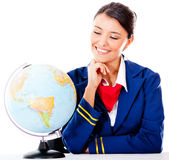 Air hostess with a globe Royalty Free Stock Photo