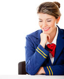 Air hostess looking at the table Royalty Free Stock Photos