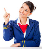 Air hostess pointing with finger Royalty Free Stock Photography