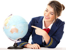 Air hostess pointing at the globe Royalty Free Stock Photos
