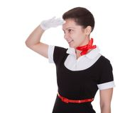 Air hostess saluting as she welcomes you Stock Image