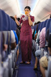 Air hostess showing oxygen mask Stock Photo