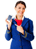 Air hostess with a smart phone Royalty Free Stock Image