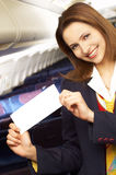 Air hostess (stewardess). In the empty airliner cabin Royalty Free Stock Photo