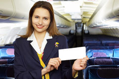 Air hostess (stewardess). Series: air hostess (stewardess) in the empty airliner cabin Royalty Free Stock Image