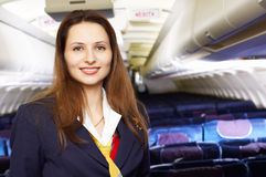 Air hostess (stewardess). In the empty airliner cabin Stock Photo