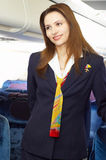 Air hostess (stewardess). In the empty airliner cabin Royalty Free Stock Photography