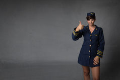 Air hostess thumbing up stock images