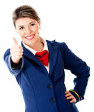 Air hostess with thumbs up Royalty Free Stock Images