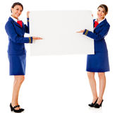 Air hostesses with a banner Stock Photography