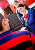 Air hostesses welcoming passenger Stock Images