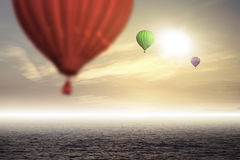 Air hot ballons in the sky. Above the sea stock photography