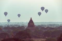 Air hot balloons on pagoda field at Bagan , Myanmar. Air hot balloons floating on top pagoda field at Bagan , Myanmar ad noise and edit color for film look royalty free stock photo