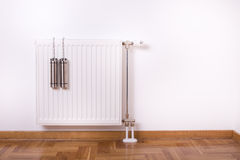 Air humidifier container on radiator Royalty Free Stock Photo