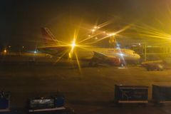 Air India aircraft around an airport terminal unique photo. A large Air India flight around a domestic airport in India at night isolated unique editorial photo stock photo
