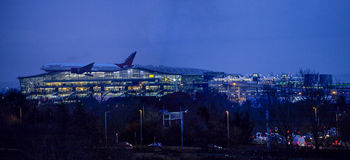 Air India plane landing at night at Heathrow Royalty Free Stock Images