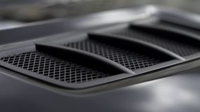 Air intake in the carbon hood of sport car. Stock. Luxury car exterior details. Air intake in the carbon hood of sport car. Luxury car exterior details stock footage